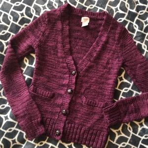 Magenta V Neck Cardigan with Brown buttons.